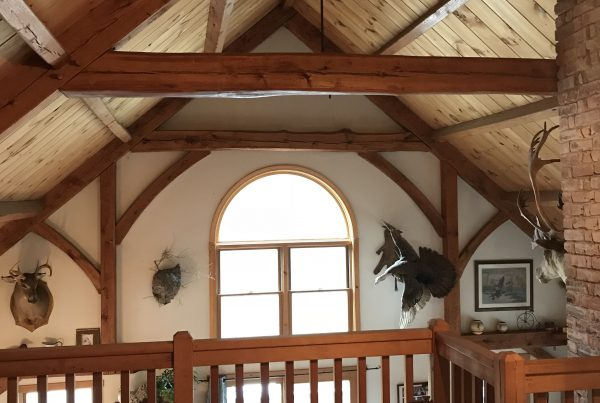 Custom built timber frame home with railing