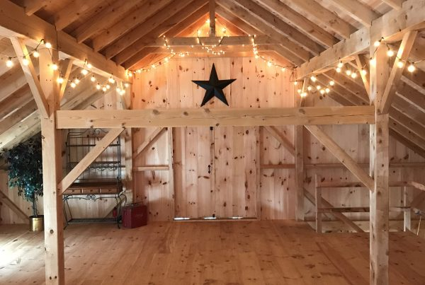 Timber Frame Barn with black star and lights